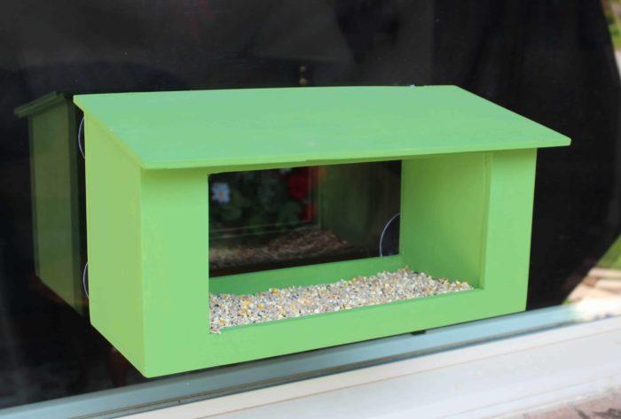 Feeder mounts on windows for watching birds