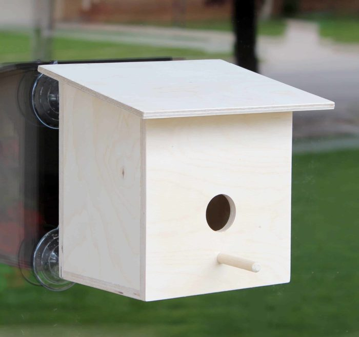 Bird house from woodworking plan that mounts on windows