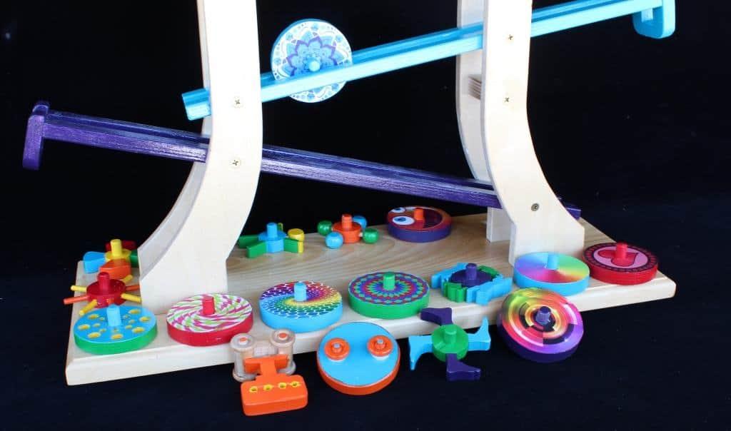 Rolling discs zig-zag down parallel tracks