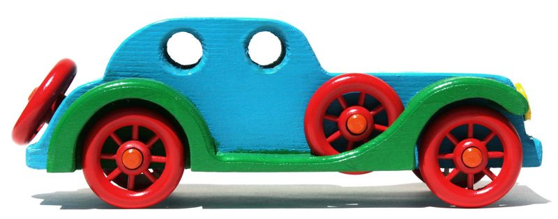Woodworking plans car. Easy to make from ful size patterns and purchased spoked wheels