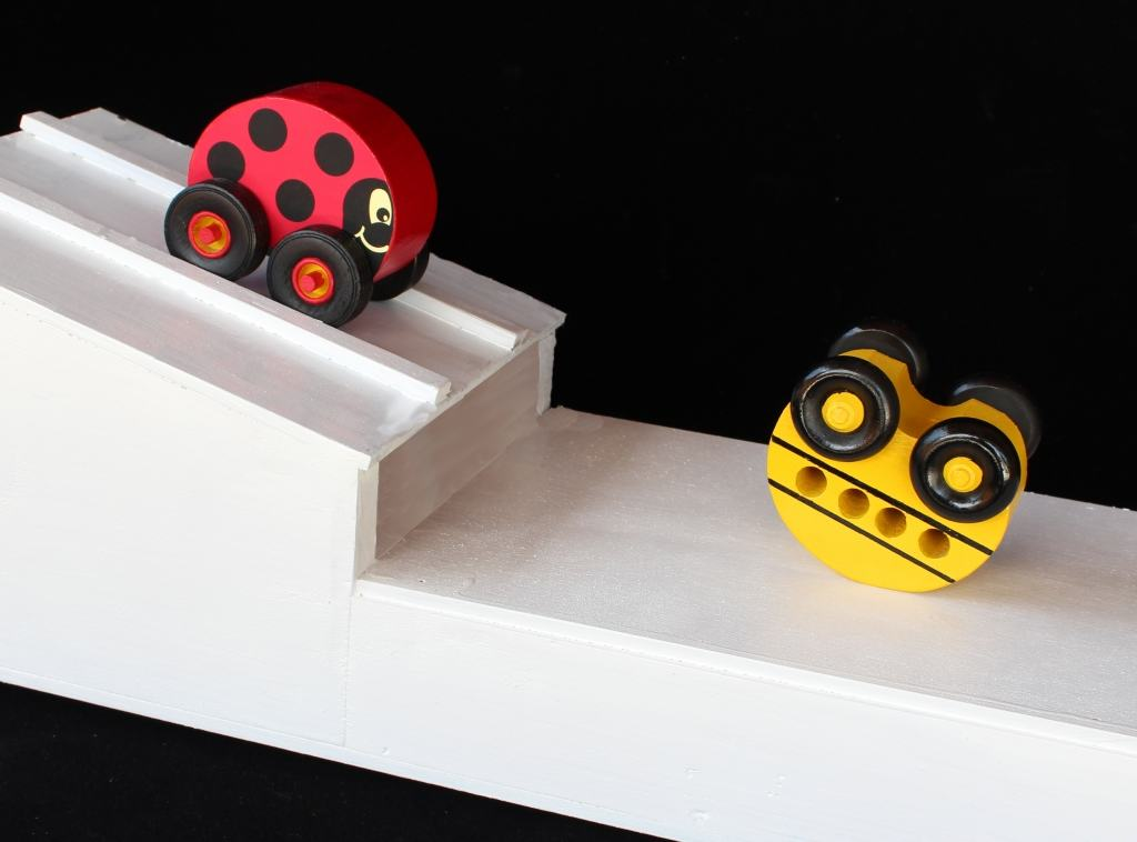 Fun toy as bug and bus flip on ramp and land upright and roll