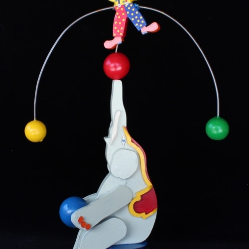 Clown balances on the elephants trunk. One of many wood toys in the plan