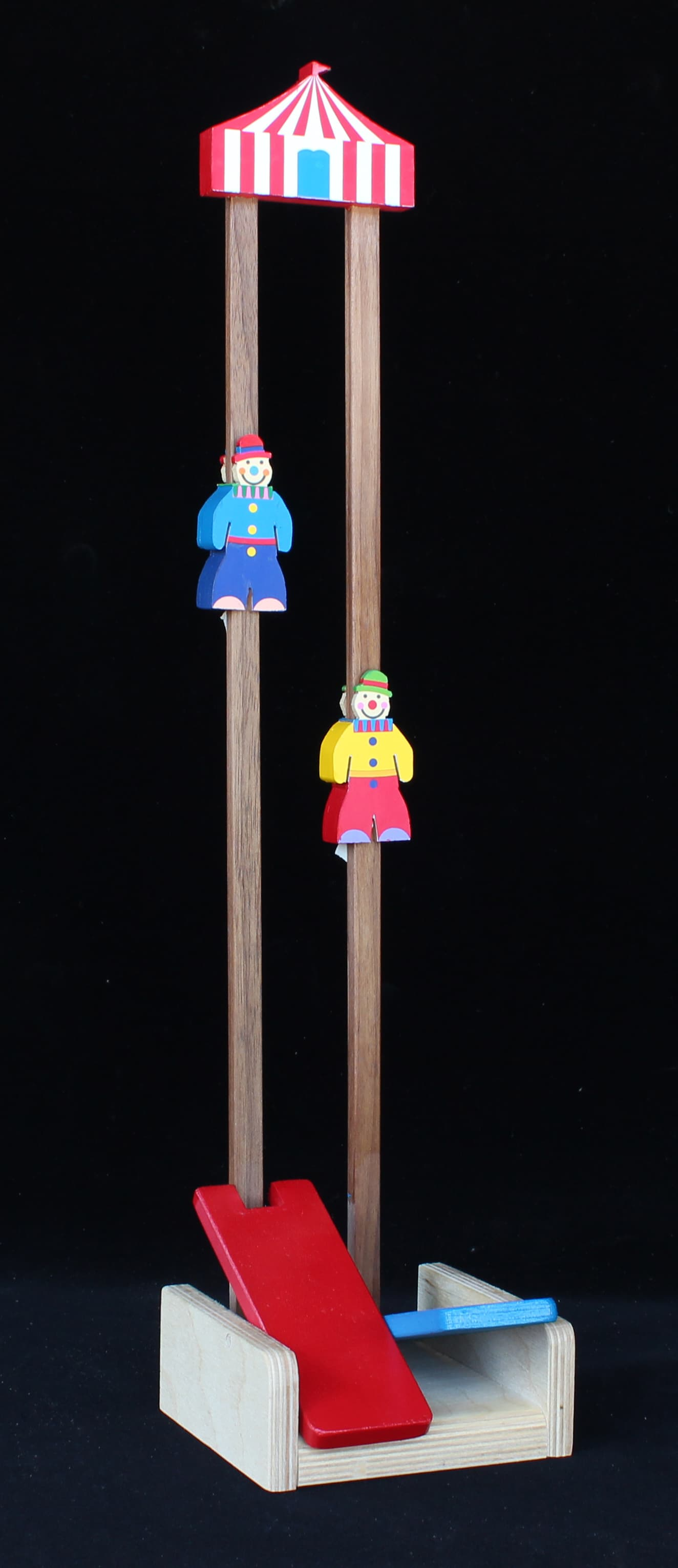 Hit the paddles and the colorful wood clowns jump to the top