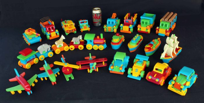 View of painted wood vehicles from the Plump'N'Tuff wood set