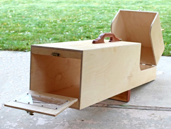 Animlal trap with door open where animals can be removed