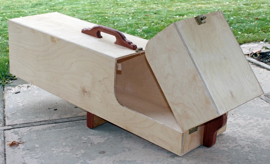 Wood animal trap in open (armed) position