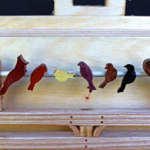 Birds roost in the top interior of the Ark. A matching section is on the other side