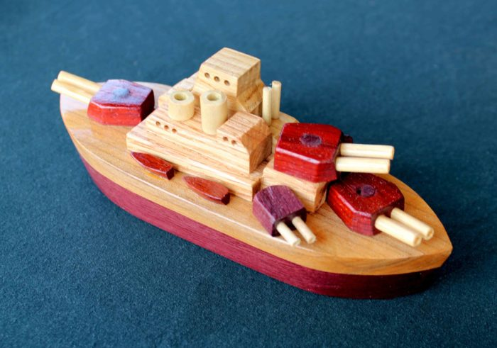 Woodworking plan for a battle ship in hardwoods