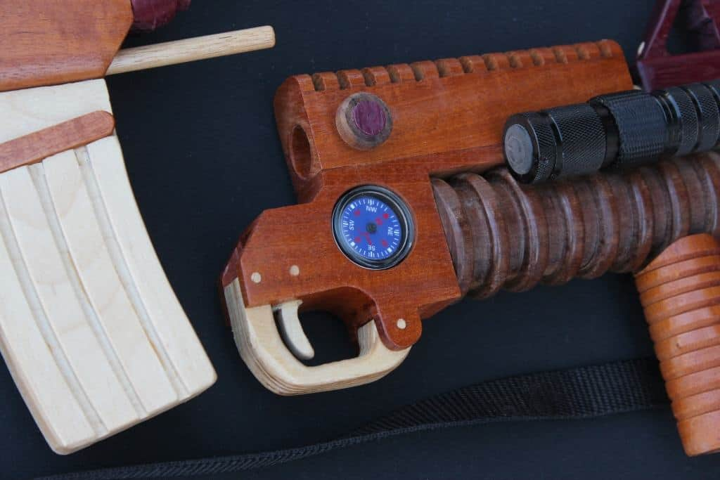 Forward end of wood weapon showing the compass and light