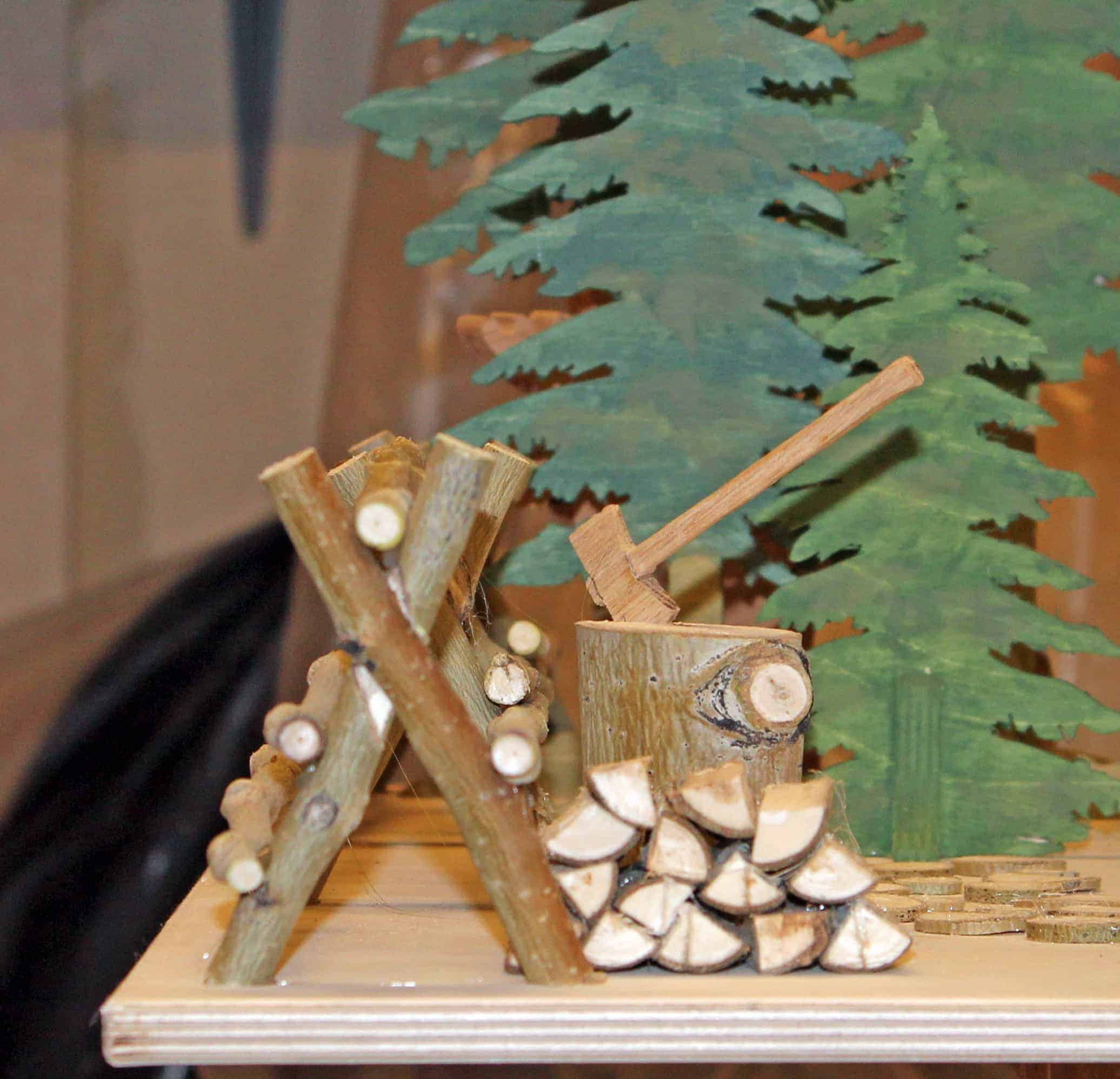 Trees, a fence, wood for the fireplace, part of the features in this wood plan package