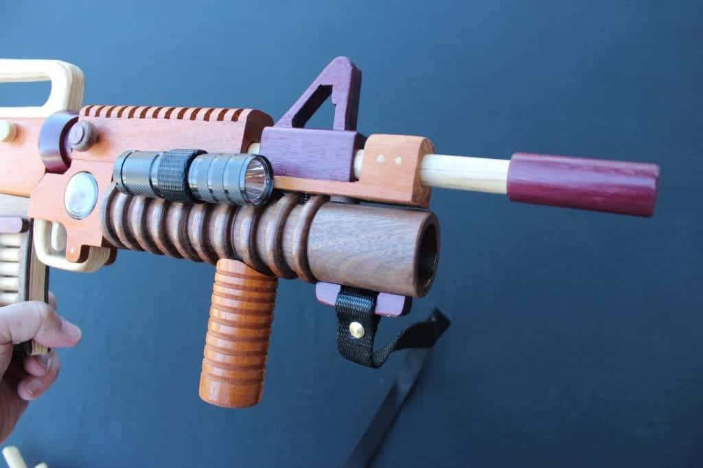 Front end of wood gun showing light and compass