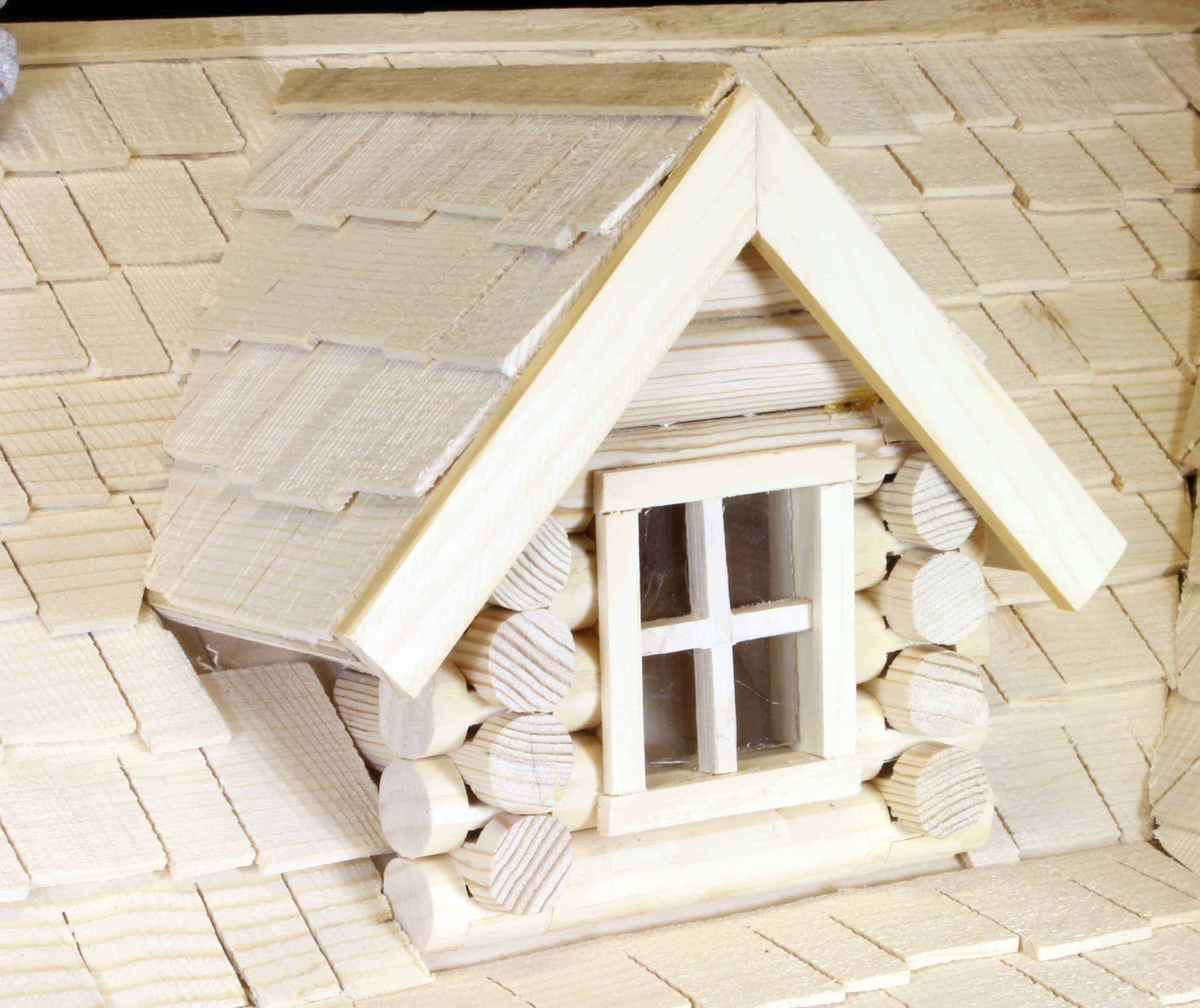 Two dormers are at the front of the cabin explained in the full size woodworking plans
