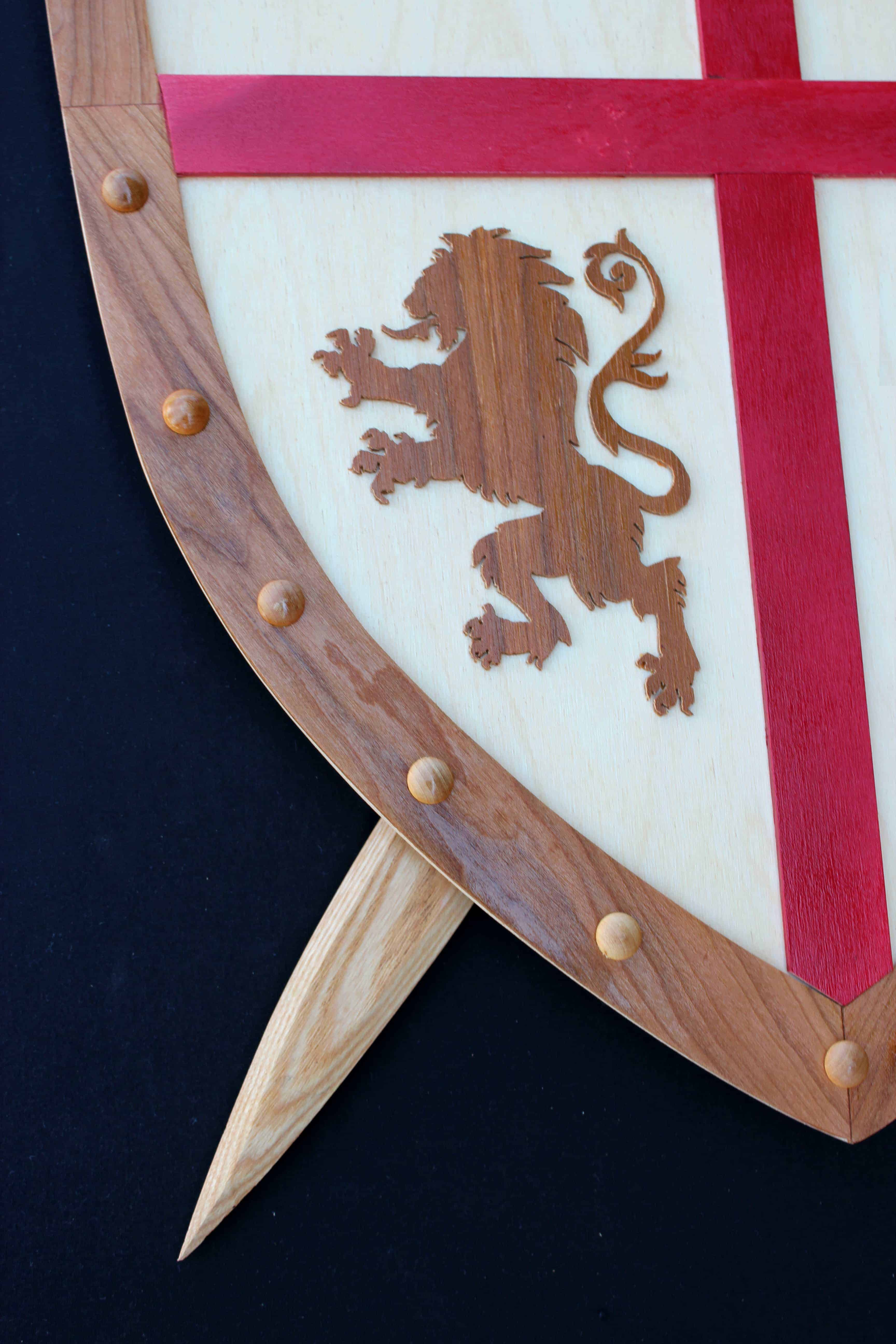 Sword and shield woodworking plan, tight view of lion insignia