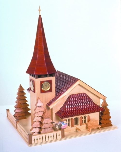Small clocks can be installed in the wood Swiss church birdhouse tower