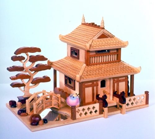 Fine detail cover the Pagoda Birdhouse including oriental features like the dragons at the doorway