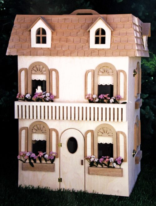 Barbie House folds closed. Move with convenient handle