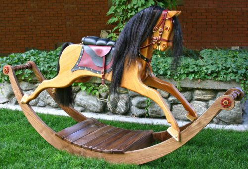 Victorian Rocking Horse in Walnut and Mahogany and uses real horse hair