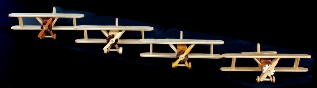 Four bi-wing planes in flight, part of a woodworking plan package