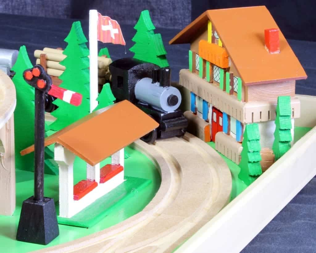 View of one secton of a large, nearly all wood train and track play set