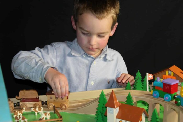 A giant train set woodworking playset with a Swiss theme