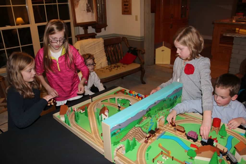 Popular wood scale train set in a Swiss setting